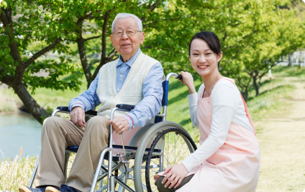 a caregiver and an old man in the park